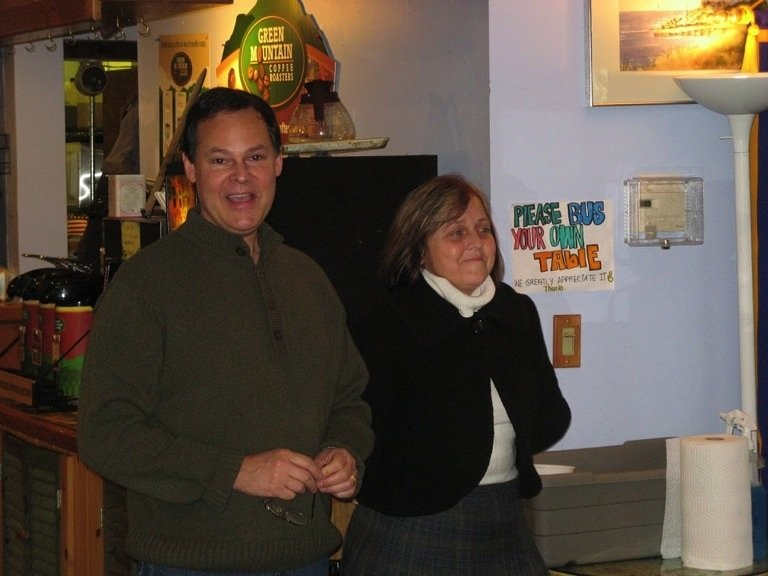 Innkeepers Dan & Penny standing and smiling in the dining area