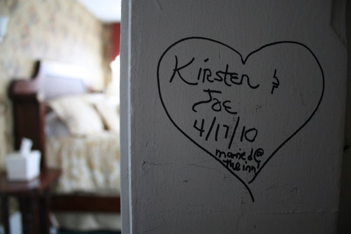 Writing on the wall of a heart that says: Kristen & Joe 4/17/10 married at the inn