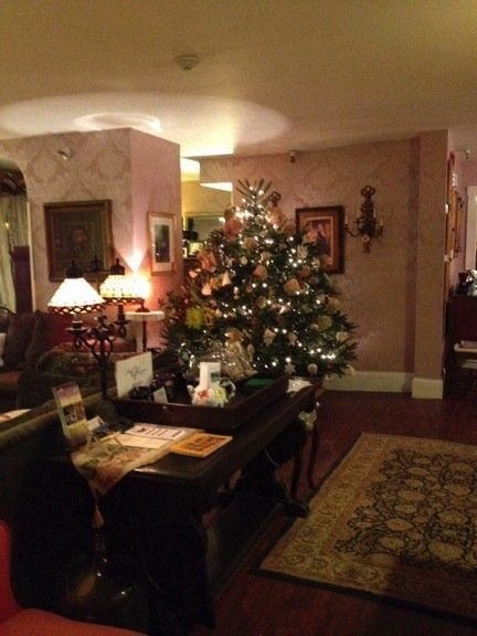 The Inn's parlor at Christmas with a beautifully lit tree