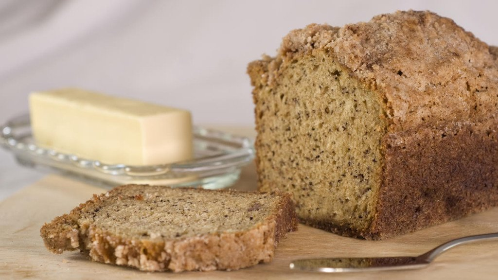 Golden baked banana bread with a dish of butter