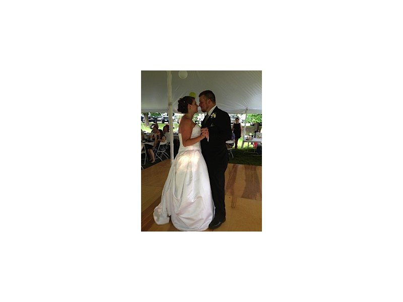 Bride and groom dancing inside the wedding tent