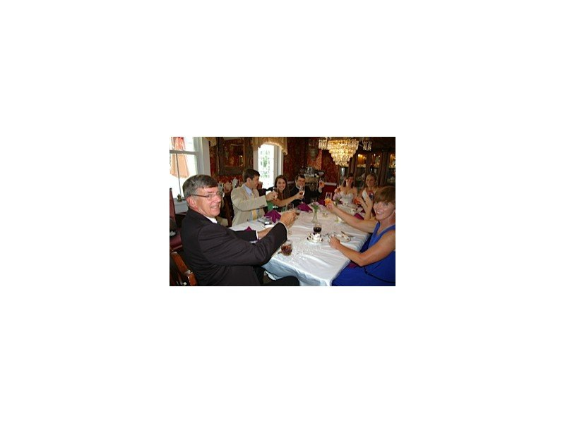 Wedding party clinking glasses at the dining room table