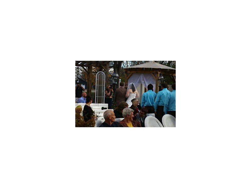 Outdoor wedding as the bride and groom and bridal party exit down the aisle