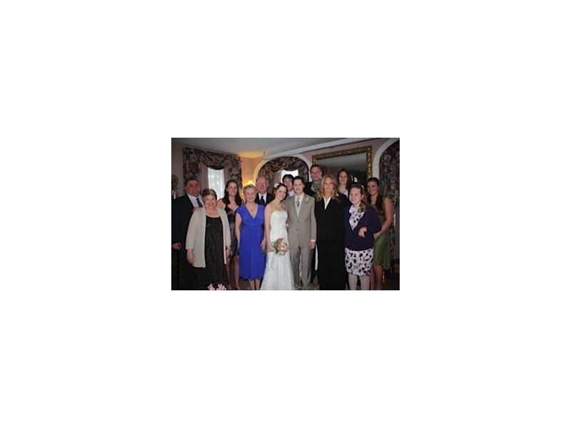 Wedding guests surrounding bride and groom
