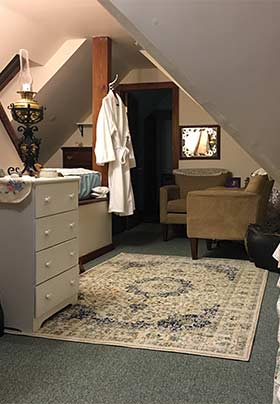 Sitting area alcove with Robe and dresser.